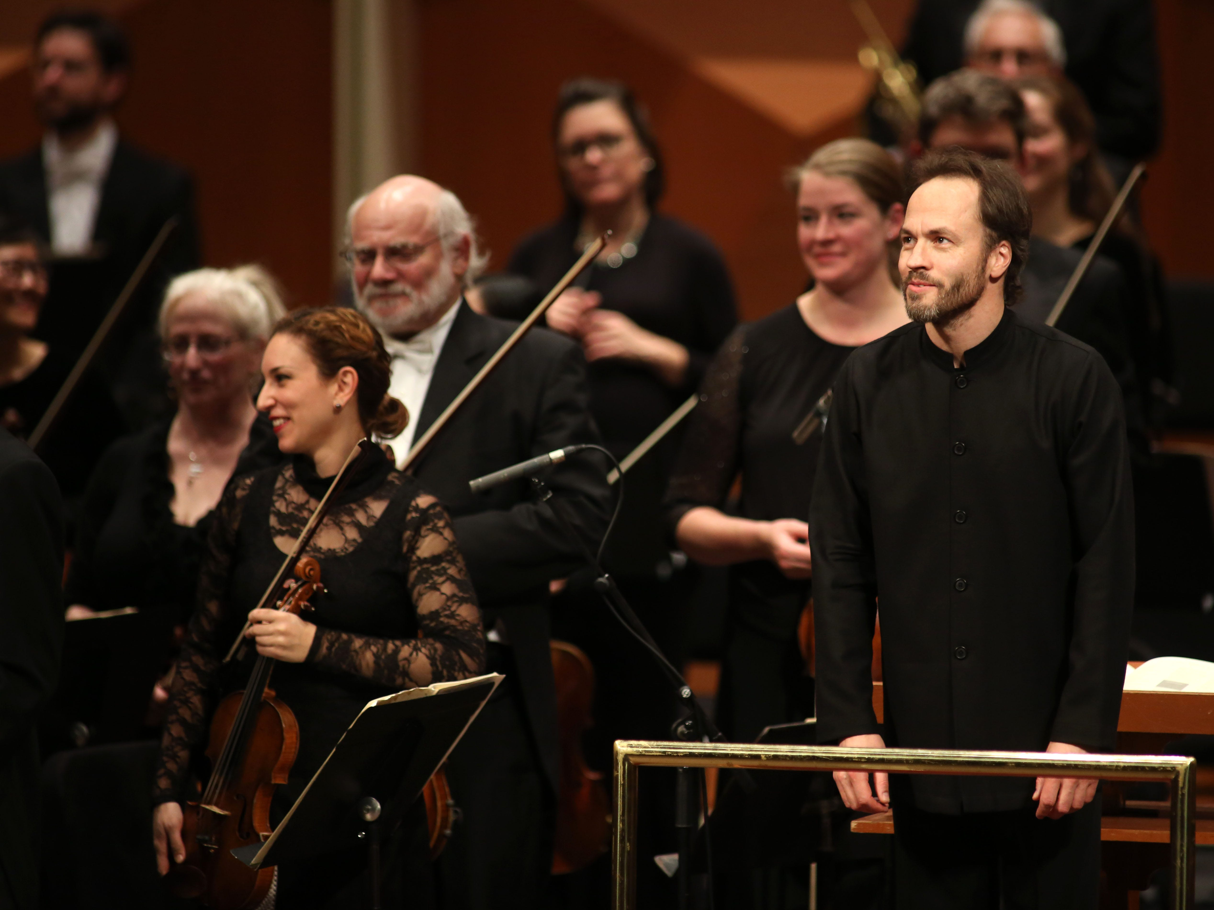 Guest conductor Johannes Debus (right) bows with the Milwaukee Symphony after a performance of Camille Saint-Saens' Symphony No 3 in C minor Saturday night at the Marcus Center.
