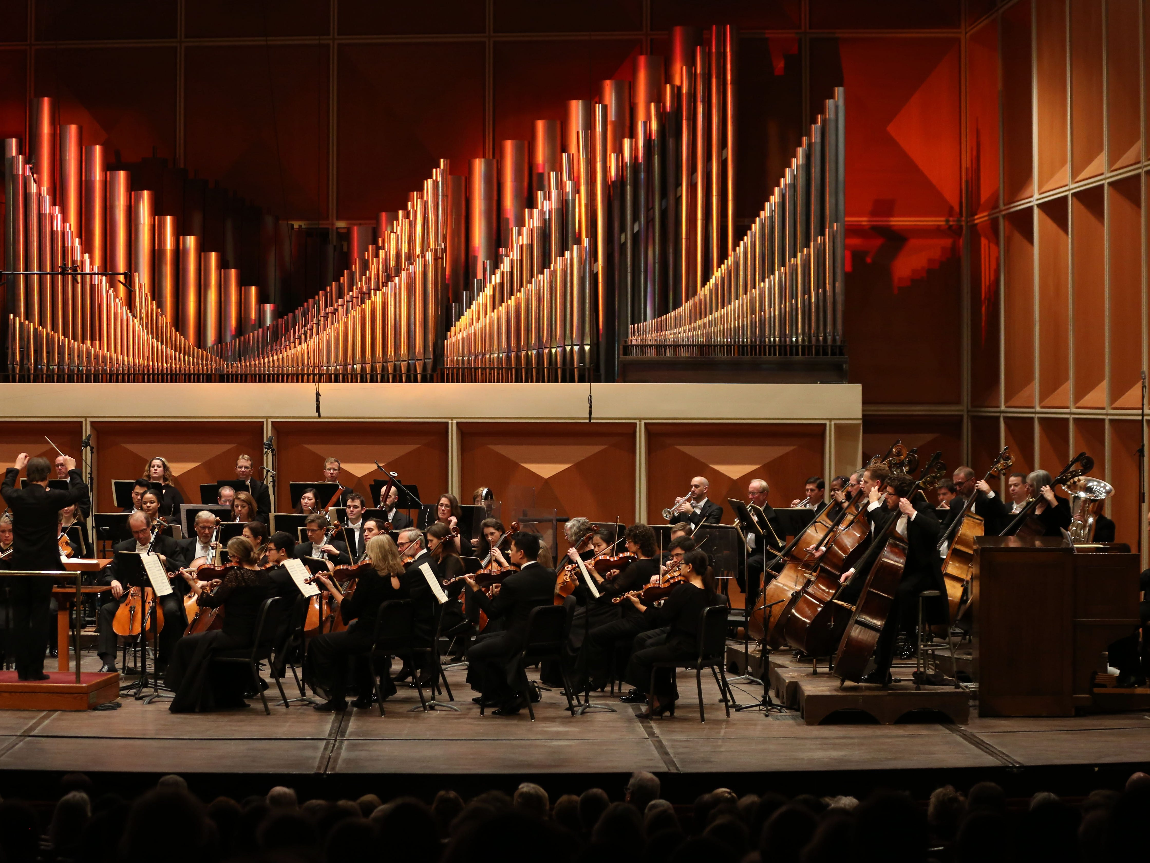 Conductor Johannes Debus leads the Milwaukee Symphony and organist David Jonies (far right) in Camille Saint-Saens' Symphony No 3 in C minor Saturday night at the Marcus Center.