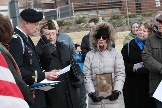 Col. John T. Oakley, commander of the 32nd Infantry Brigade Combat Team, speaks at the event. Holding the microphone is Alex Kaleta of VFW Post 1465, and at right is Jill Gaertner of Wauwatosa, who holds a photo of her grandfather Herman Schmidt who served in World War I.