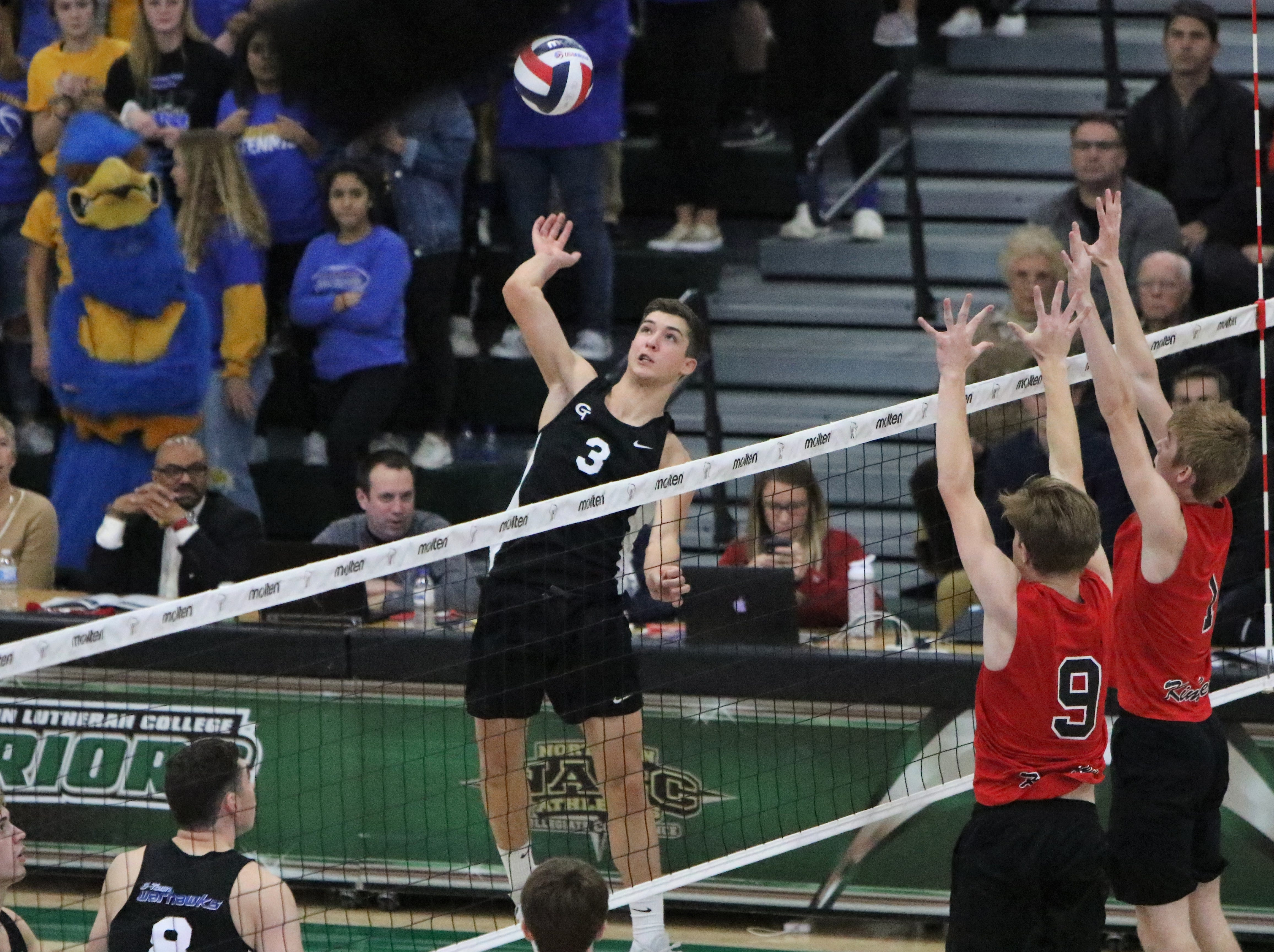Germantown junior Drew Jansen winds up for a kill attempt during the WIAA state championship match against Kimberly on Saturday.