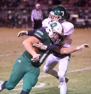Yellville-Summit's Britten Roberts tackles Danville's Evan Lane on Friday night.