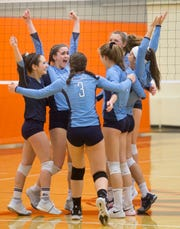 West Morris Central celebrates after scoring during the NJSIAA volleyball group three finals at William Paterson Recreation Center. West Morris Central won 25-18, 25-20.