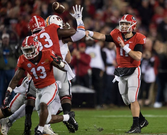 Georgia quarterback Jake Fromm (11) throws the ball down field at Sanford Stadium in Athens, Ga., on Saturday, Nov. 10, 2018. Georgia defeated Auburn 27-10.