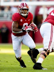 Alabama running back Josh Jacobs (8) carries the ball against Mississippi State in first half action at Bryant Denny Stadium in Tuscaloosa, Ala., on Saturday November 9, 2018.