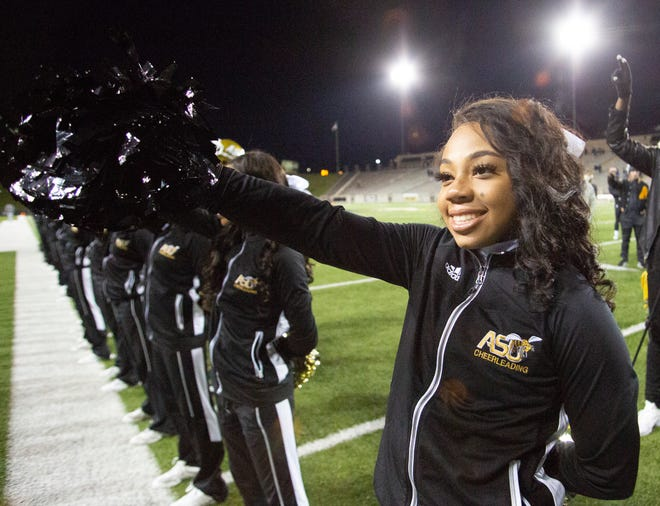 An Alabama State cheerleader keeps her smile on despite the homecoming loss.
