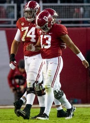 Alabama offensive lineman Jedrick Wills, Jr., (74) helps Alabama quarterback Tua Tagovailoa (13) off the field in second half action against Mississippi State at Bryant Denny Stadium in Tuscaloosa, Ala., on Saturday November 9, 2018.