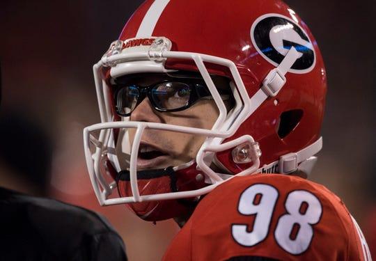 Georgia kicker Rodrigo Blankenship (98) watches a replay from the sideline at Sanford Stadium in Athens, Ga., on Saturday, Nov. 10, 2018. Georgia defeated Auburn 27-10.