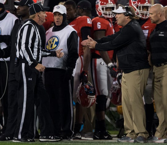Georgia head coach Kirby Smart argues with an official after a sideline warning at Sanford Stadium in Athens, Ga., on Saturday, Nov. 10, 2018. Georgia defeated Auburn 27-10.
