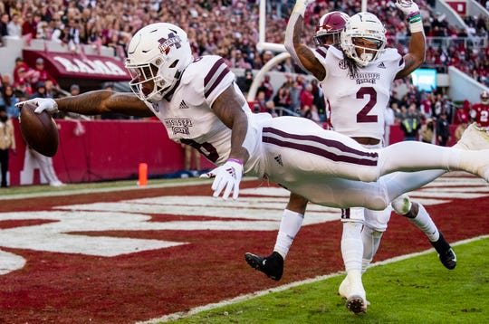 Mississippi State running back Kylin Hill (8)  dives for the end zone against Alabama on a play that was called back on a penalty in first half action at Bryant Denny Stadium in Tuscaloosa, Ala., on Saturday November 9, 2018.