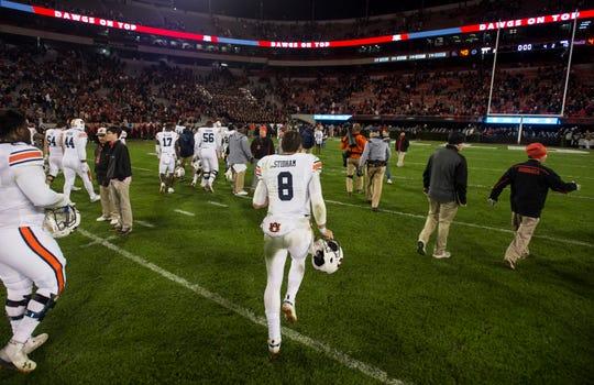 Auburn quarterback Jarrett Stidham (8) runs off the field after the game at Sanford Stadium in Athens, Ga., on Saturday, Nov. 10, 2018. Georgia defeated Auburn 27-10.
