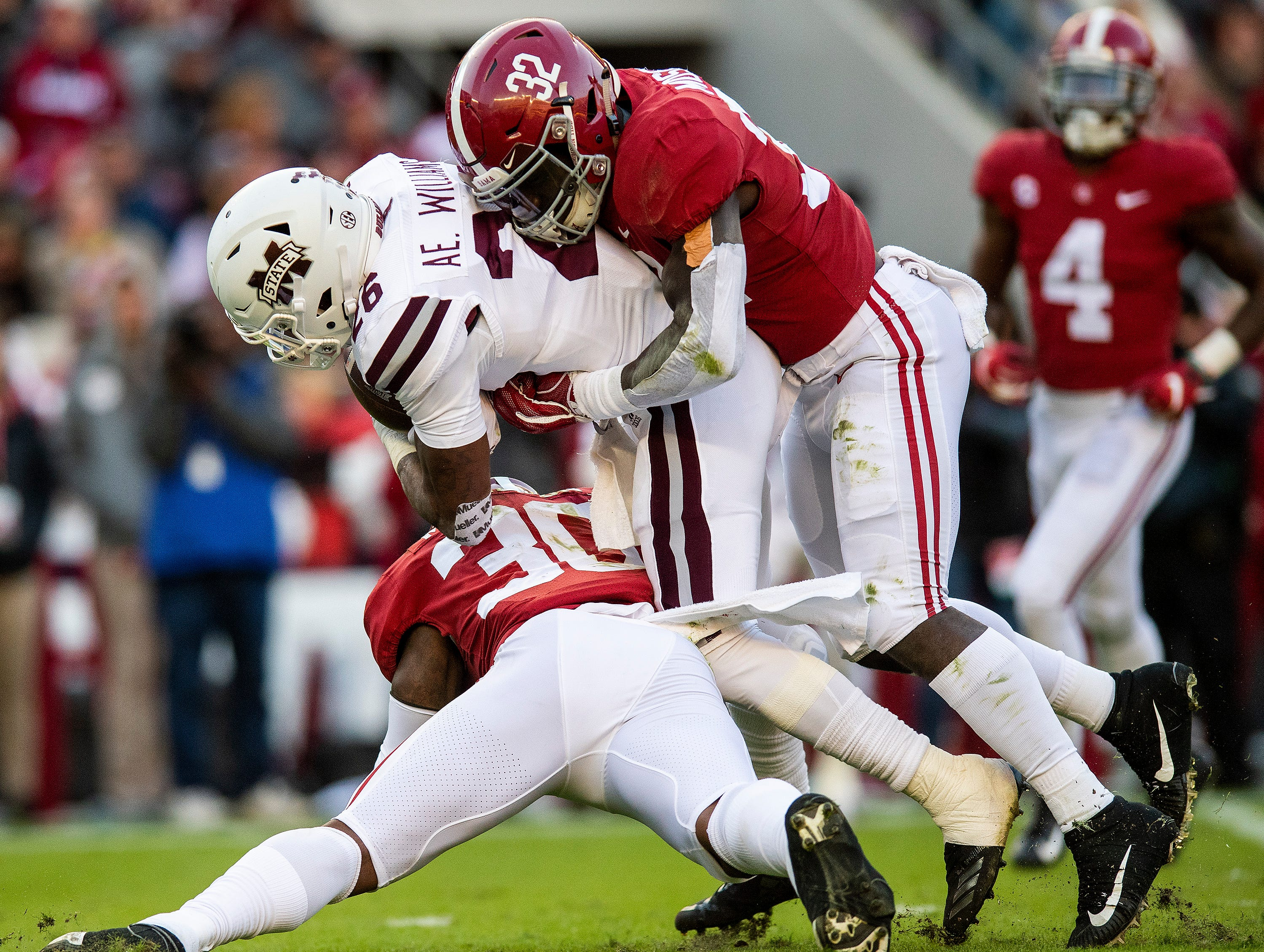 Alabama linebackers Mack Wilson (30) and Dylan Moses (32) tackle Mississippi State running back Aeris Williams (26) in first half action at Bryant Denny Stadium in Tuscaloosa, Ala., on Saturday November 9, 2018.