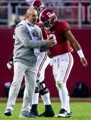 Alabama quarterback Tua Tagovailoa (13) is helped off of the field after being injured in second half action against Mississippi State at Bryant Denny Stadium in Tuscaloosa, Ala., on Saturday November 9, 2018.