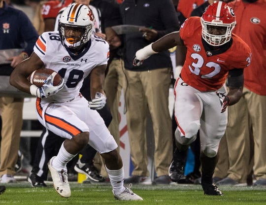 Auburn wide receiver Seth Williams (18) turns up the field after making a catch against Georgia at Sanford Stadium in Athens, Ga., on Saturday, Nov. 10, 2018. Georgia leads Auburn 20-10 at halftime.