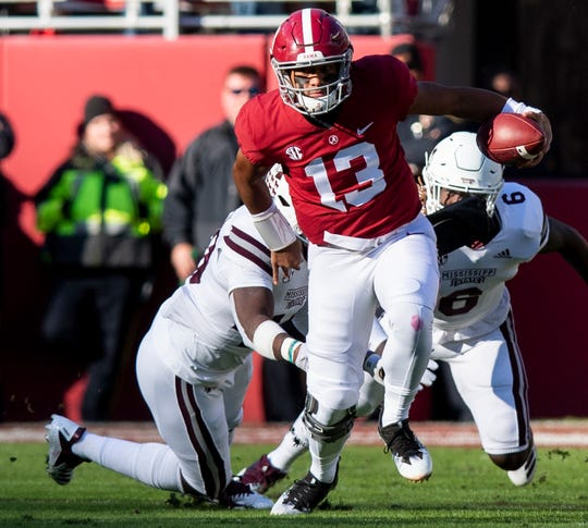 Alabama quarterback Tua Tagovailoa (13) scrambles for yardage against Mississippi State in first half action at Bryant Denny Stadium in Tuscaloosa, Ala., on Saturday November 9, 2018.