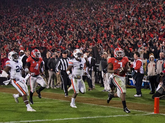 Georgia running back D'Andre Swift (7) runs into the end zone after breaking a 77-yard run against  Auburn at Sanford Stadium in Athens, Ga., on Saturday, Nov. 10, 2018. Georgia defeated Auburn 27-10.