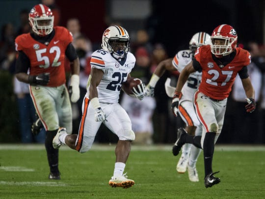 Auburn running back Shaun Shivers (25) runs the ball down field against Georgia at Sanford Stadium in Athens, Ga., on Saturday, Nov. 10, 2018. Georgia defeated Auburn 27-10.