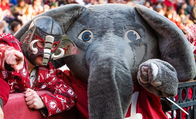 Alabama fan Collin Littlefield hangs out with Alabama mascot Big Al during first half action against Mississippi State at Bryant Denny Stadium in Tuscaloosa, Ala., on Saturday November 9, 2018.