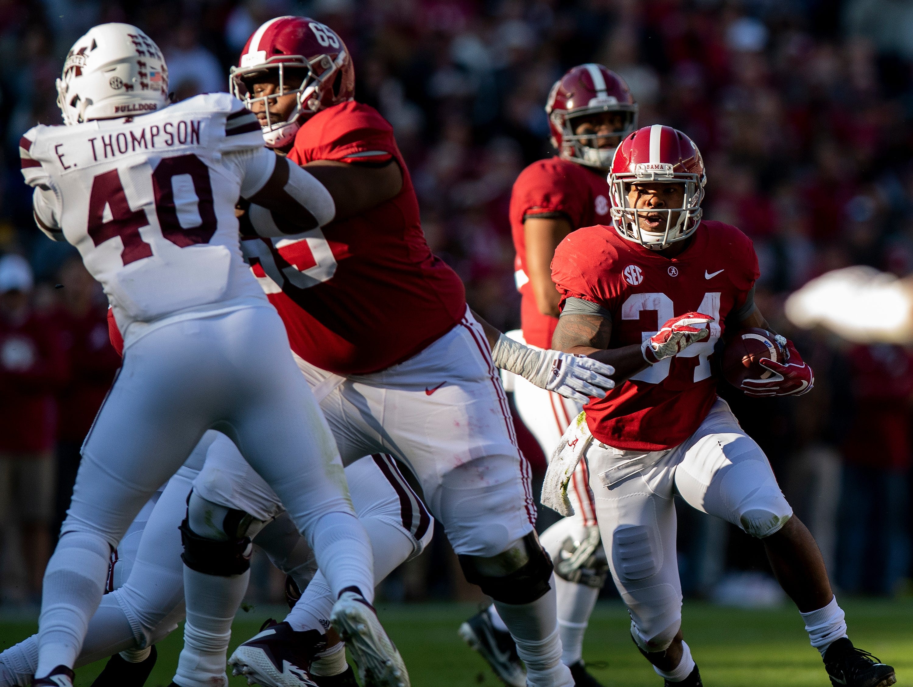 Alabama running back Damien Harris (34) carries the ball behind the blocking of Alabama offensive lineman Deonte Brown (65) against Mississippi State in first half action at Bryant Denny Stadium in Tuscaloosa, Ala., on Saturday November 9, 2018.