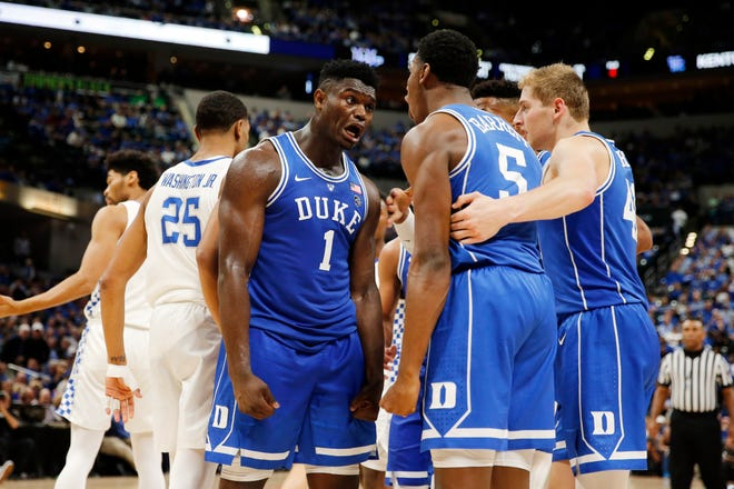 Duke forward Zion Williamson (1) and guard RJ Barrett (5) react in a game against Kentucky during the Champions Classic at Bankers Life Fieldhouse on Nov. 6, 2018, in Indianapolis.