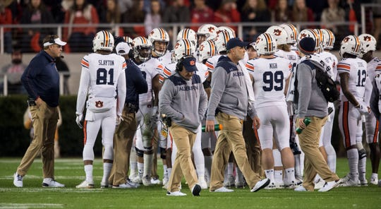 Auburn head coach Gus Malzahn huddles up with his team at Sanford Stadium in Athens, Ga., on Saturday, Nov. 10, 2018. Georgia defeated Auburn 27-10.