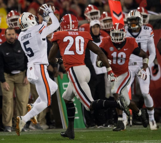 Auburn wide receiver Anthony Schwartz (5) catches the ball on the sideline at Sanford Stadium in Athens, Ga., on Saturday, Nov. 10, 2018. Georgia defeated Auburn 27-10.