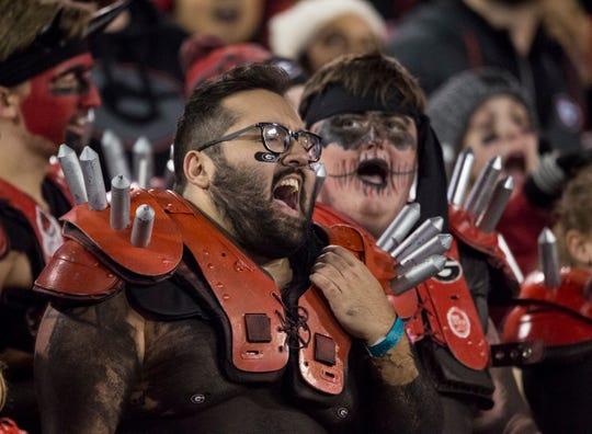 Georgia fans sing along to the stadium music at Sanford Stadium in Athens, Ga., on Saturday, Nov. 10, 2018. Georgia defeated Auburn 27-10.