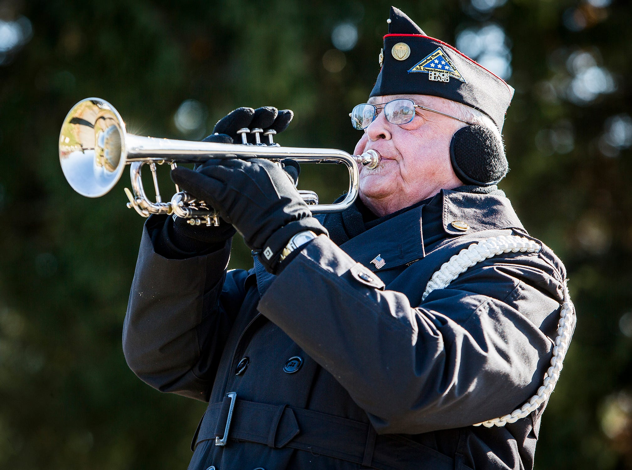 Taps is performed by the Delaware County Honor Guard during the Delaware County Veterans Day Service at Beech Grove Cemetery Sunday morning.