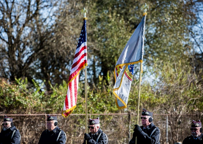 Flags are displayed during a past year's Veterans Day service at Beech Grove Cemetery.