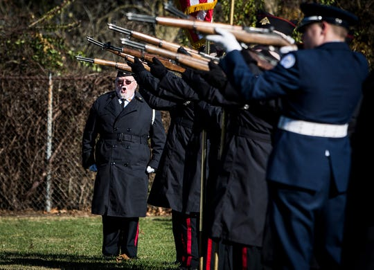 The Delaware County Honor Guard performed a rifle salute in the American Legion Section of Beech Grove Cemetery for a 2018 Veterans Day service.