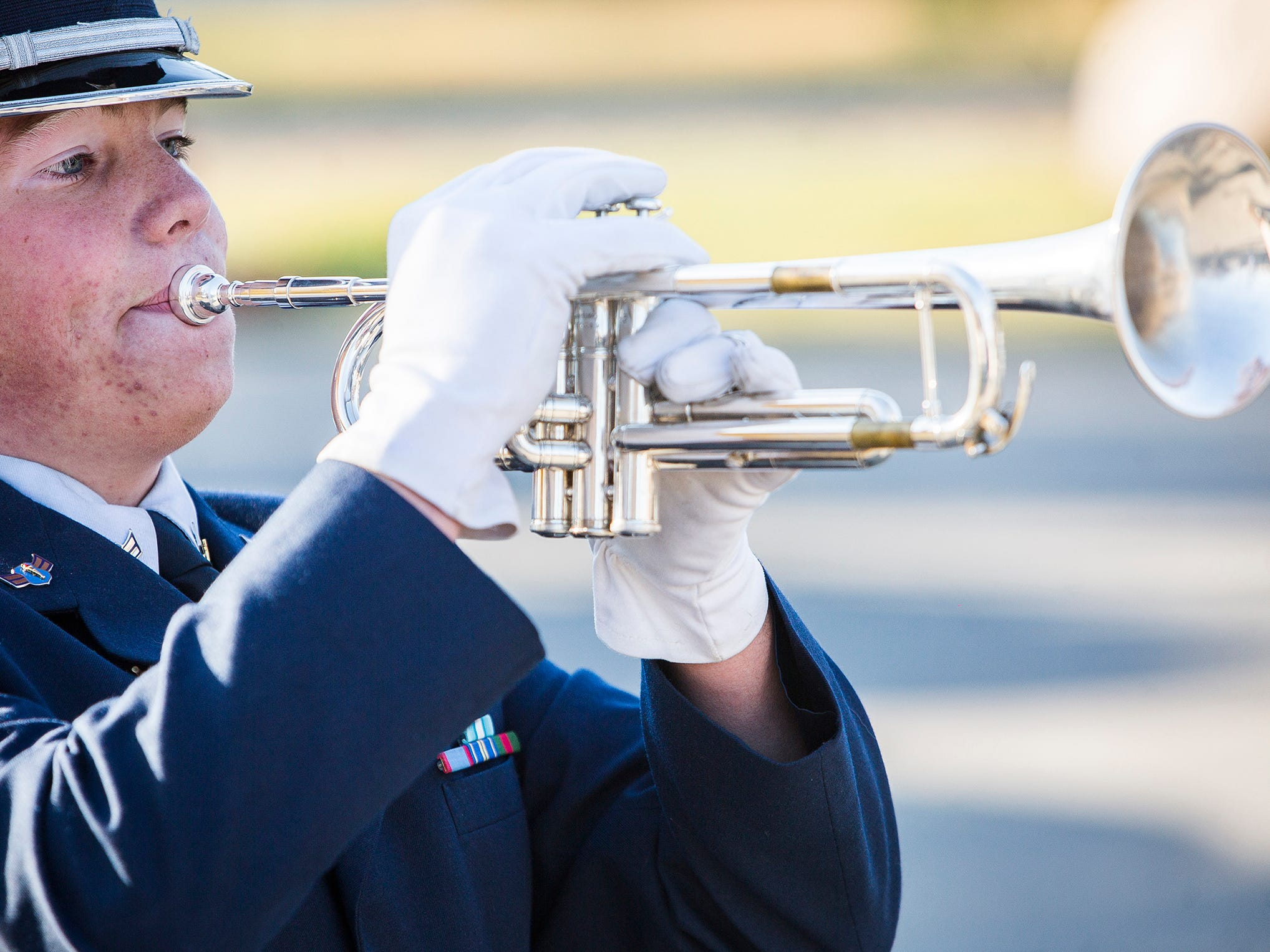 Taps is performed at Heekin Park during the Delaware County Veterans Day program.