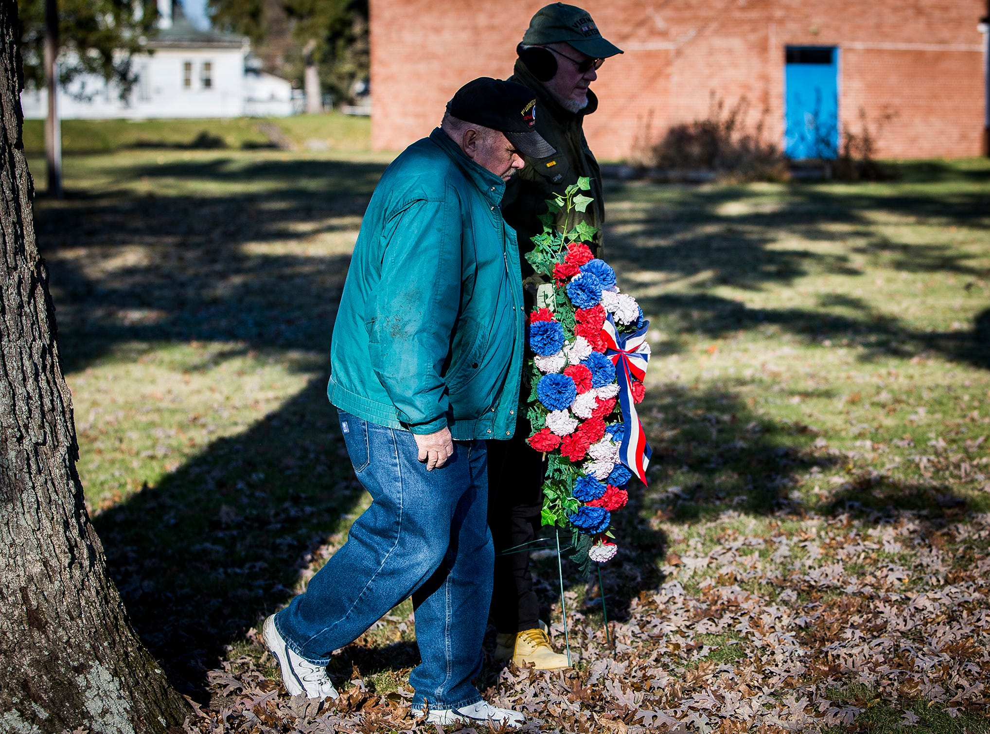 Vietnam veteran Gary Turner spoke during the Delaware County Veterans Day Service at Heekin Park Sunday morning. The Delaware County Honor Guard performed a rifle salute during the ceremony and Chaplin Hank Hansen led attendees in a prayer for veterans.