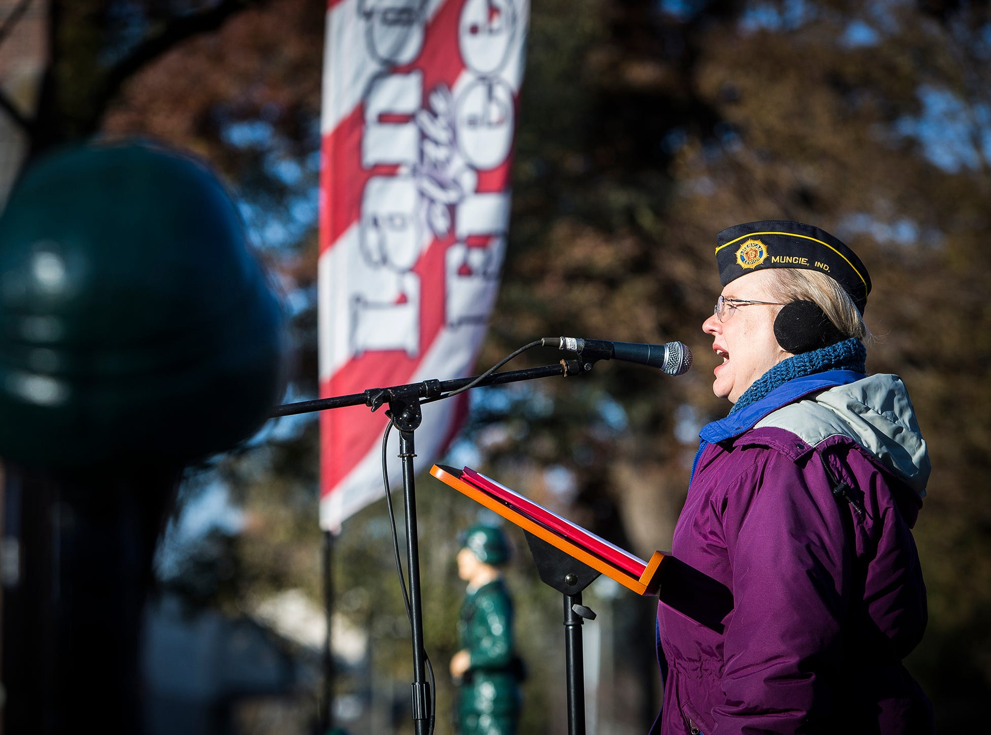 Veteran Ruth Berkey sings the National Anthem during the Delaware County Veterans Day Service at Heekin Park Sunday morning. The Delaware County Honor Guard performed a rifle salute during the ceremony and Chaplin Hank Hansen led attendees in a prayer for veterans.