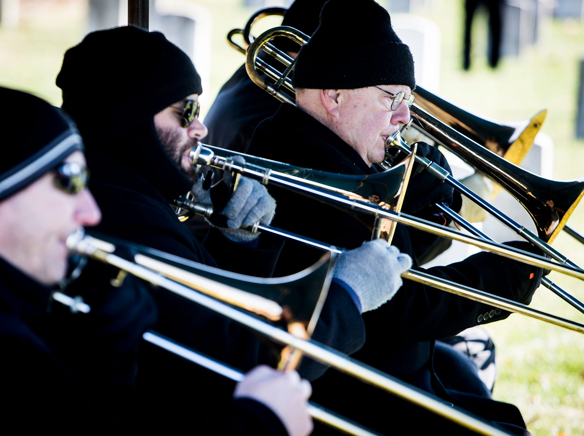 The America's Hometown Band Trombone Quartet performs during the Delaware County Veterans Day Service at Beech Grove Cemetery Sunday morning.