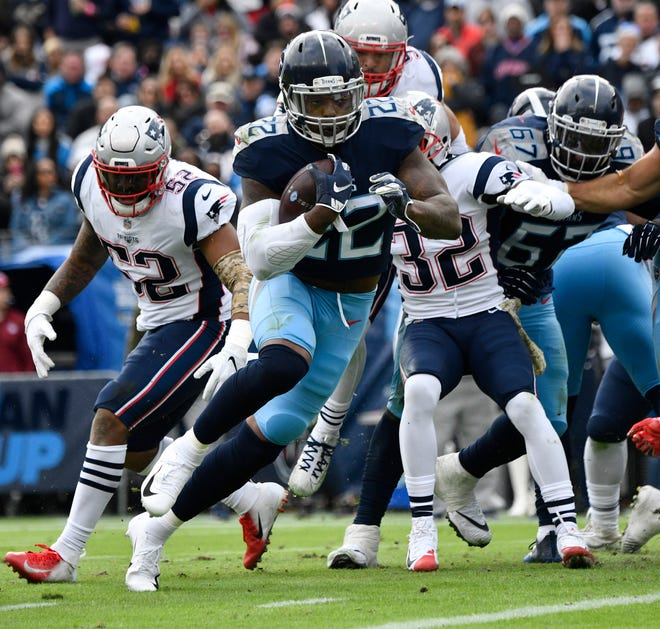 Titans running back Derrick Henry (22) scores one of his two touchdowns Sunday.