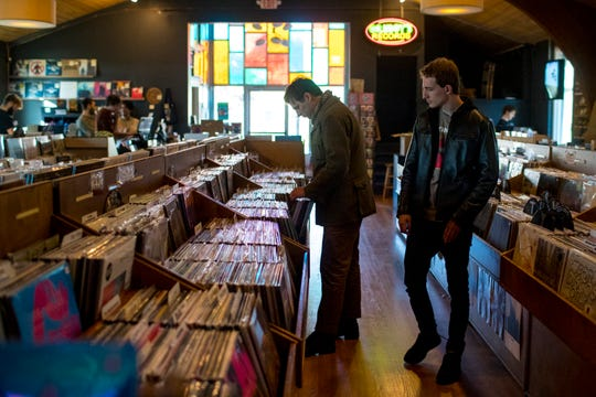 Patrons browse the records at the new location of Grimey's New & Preloved Music in Nashville on Saturday, Nov. 10, 2018.