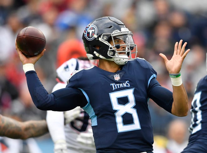Titans quarterback Marcus Mariota (8) passes in the second half Sunday.
