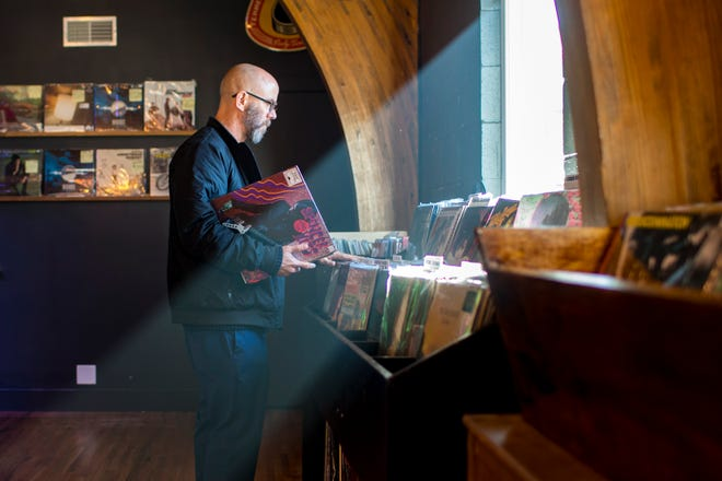 Dan Sullivan browses records at the new location of Grimey's New & Preloved Music in Nashville on Saturday, Nov. 10, 2018.