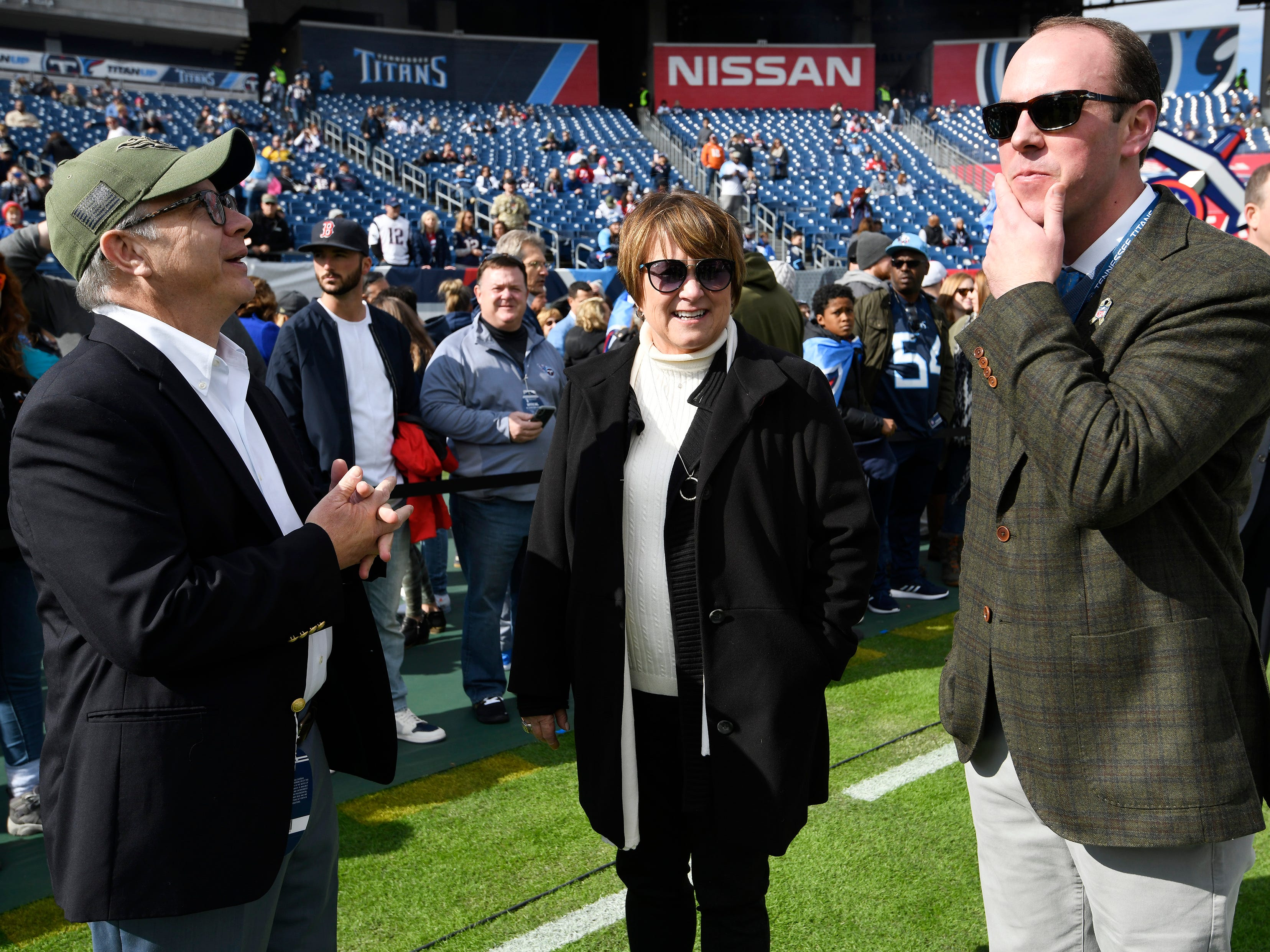 Nashville Mayor David Briley chats with Titans owners Amy Adams Strunk and her nephew Kenneth Adams IV before the game at Nissan Stadium Sunday, Nov. 11, 2018, in Nashville, Tenn.