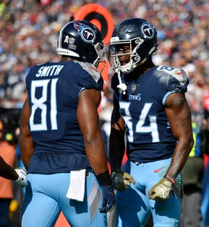 Titans wide receiver Corey Davis (84) celebrates his touchdown catch with tight end Jonnu Smith (81) in the first quarter Sunday.