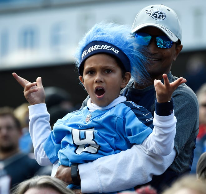 A Titans fan cheers during the first half Sunday.