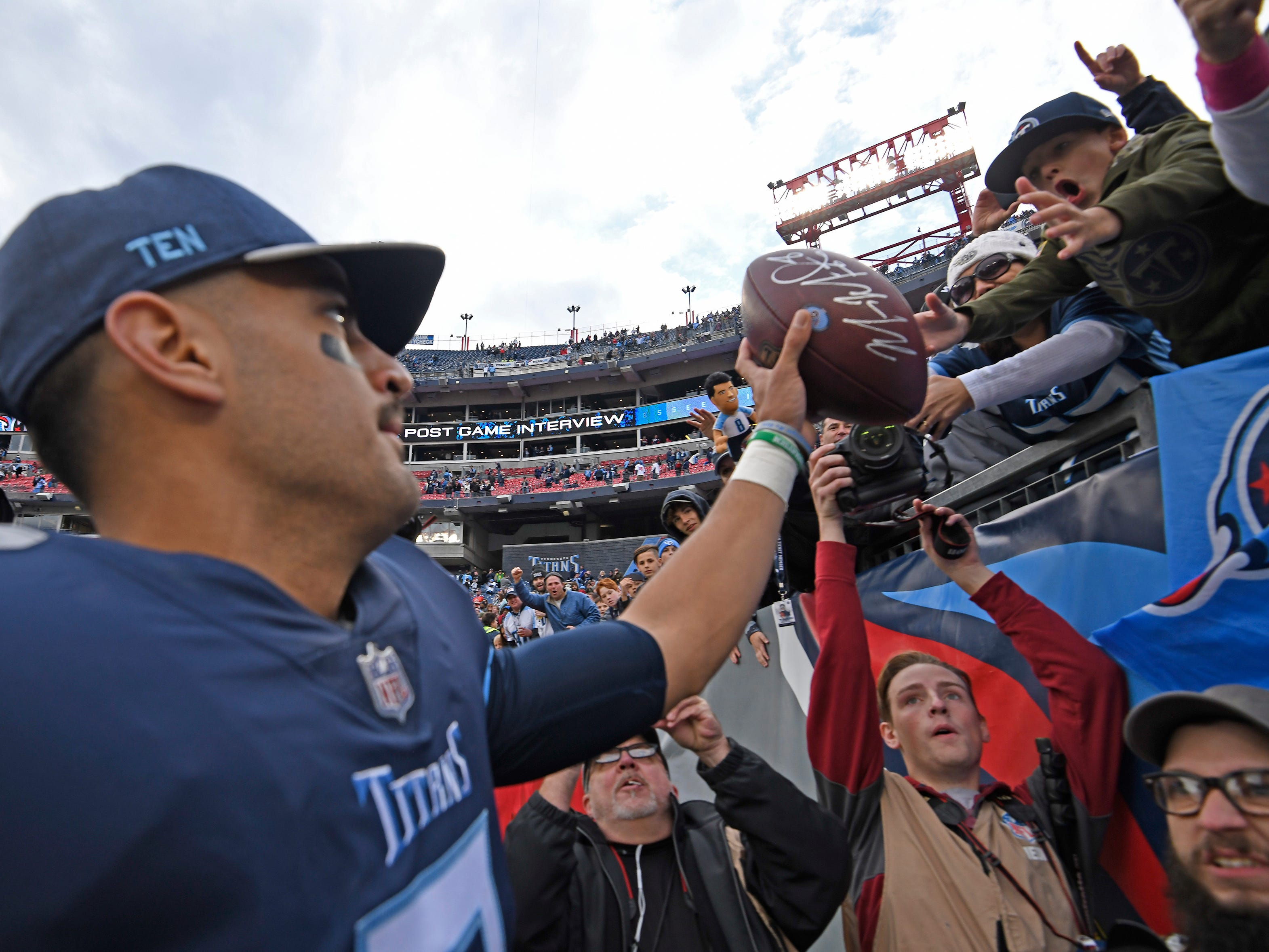 Titans quarterback Marcus Mariota (8) greets fans after the team'[s 34-10 win over the Patriots at Nissan Stadium Sunday, Nov. 11, 2018, in Nashville, Tenn.
