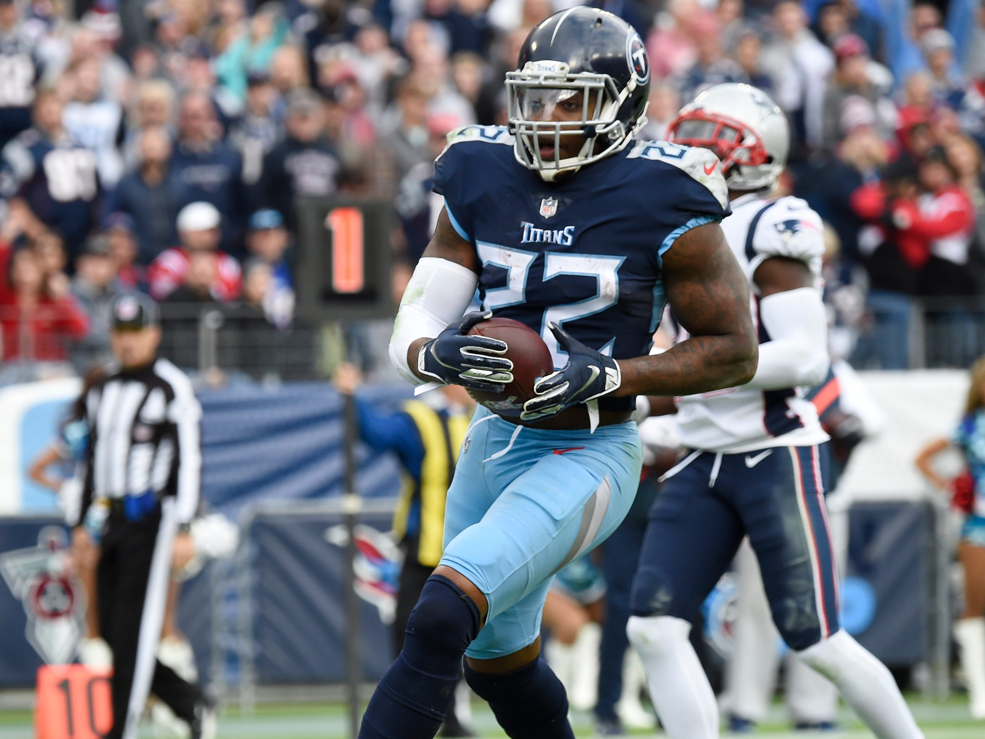 Titans running back Derrick Henry (22) scores his second touchdown of the game against the Patriots at Nissan Stadium Sunday, Nov. 11, 2018, in Nashville, Tenn.