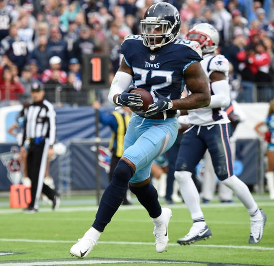 Titans running back Derrick Henry (22) scores his second touchdown of the game Sunday.