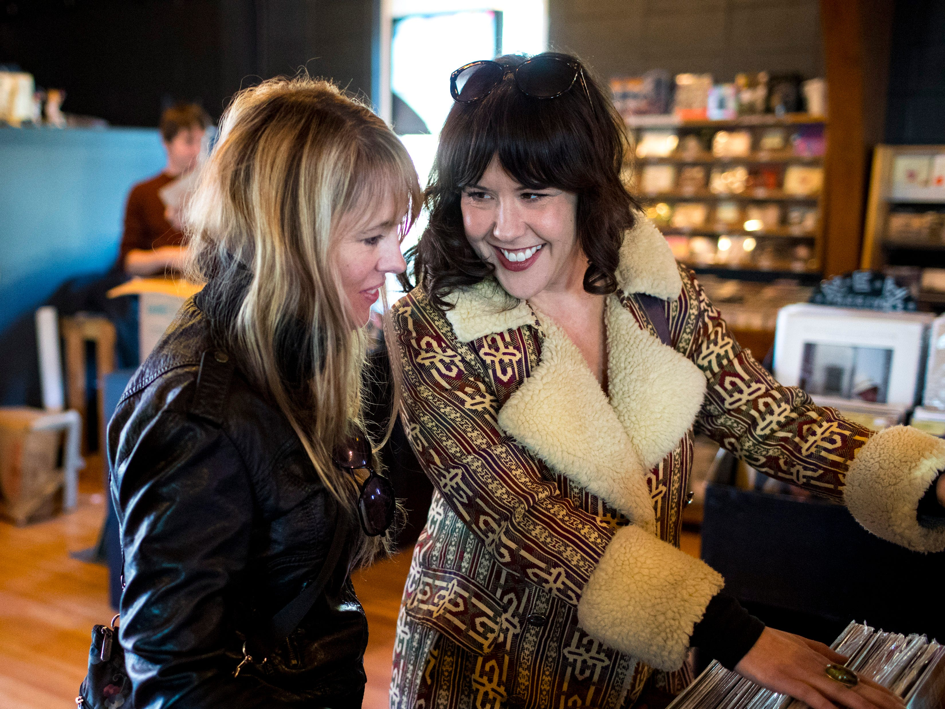 Sulayla Arnett, left, and Kashena Sampson browse the records at the new location of Grimey's New & Preloved Music in Nashville on Saturday, Nov. 10, 2018.