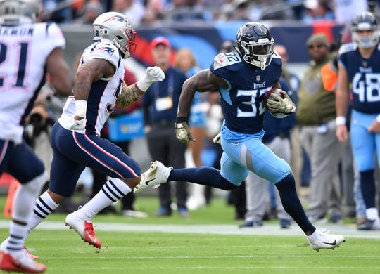 Titans running back David Fluellen (32) gains yards in the second quarter at Nissan Stadium Sunday, Nov. 11, 2018, in Nashville, Tenn.