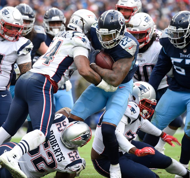 Titans running back Derrick Henry (22) is stopped by the Patriots defense on Nov. 11.