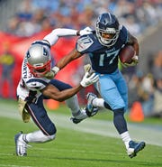 Titans wide receiver Cameron Batson gains yards against Patriots cornerback Jason McCourty on Nov. 11.