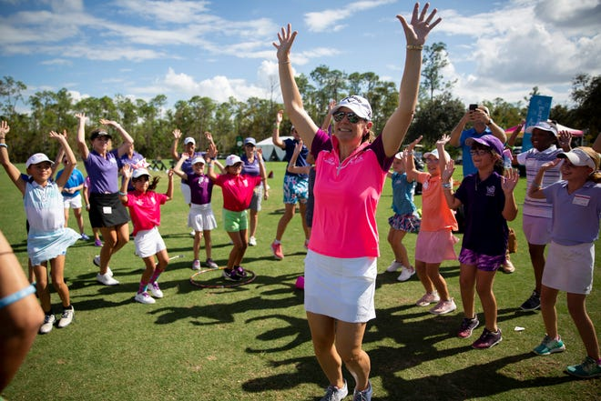 """Annika Sorenstam dances to """"Happy"""" by Pharrell Williams during a """"Share My Passion"""" Girls Golf Clinic on Sunday at Tiburón Golf Club in Naples."""