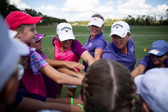 "Annika Sorenstam puts her hand in for a huddle with coaches and participants during a ""Share My Passion"" Girls Golf Clinic on Sunday at Tiburón Golf Club in Naples."