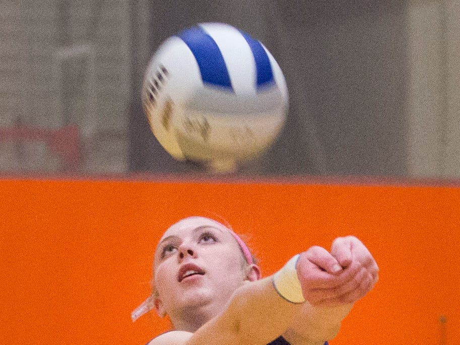 Northern Valley Regional at Demarest's Sedona Gaard (7) volleys the ball against Rutherford High School during the NJSIAA volleyball group two finals at William Paterson Recreation Center. Demarest won 25-13, 25-9.